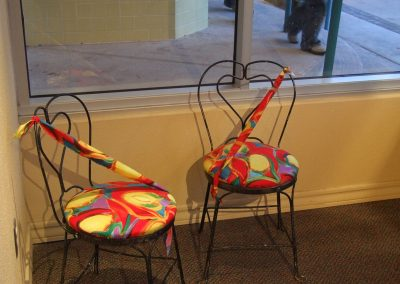 picture of two chairs with mendoza's painting on the seats