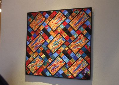 picture of mendoza's abstract painting with rectangles and square shapes