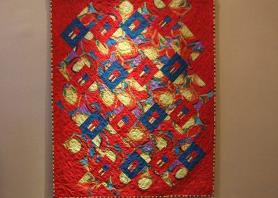 picture of mendoza's painting with a red background and squares and shapes throughout