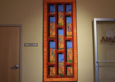picture of mendoza's painting with orange and brown background and rectangles throughout