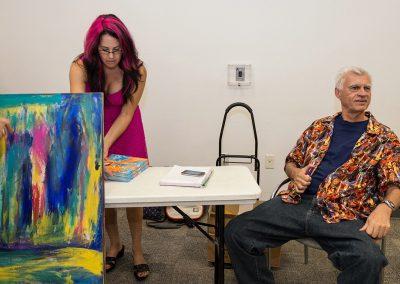 mendoza sitting down at his book signing