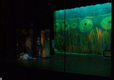 set of a play using mendoza's artwork