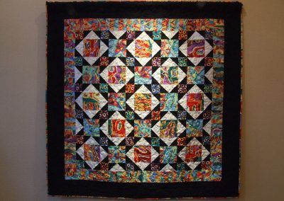 picture of mendoza's work with black border and colorful abstract squares