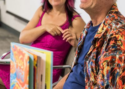 mendoza smiling and answering questions at his book signing