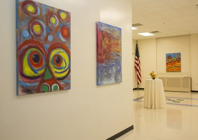 photo of mendoza's artworks in a gallery