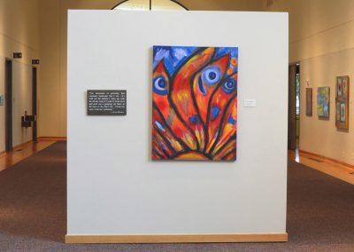 photo of mendoza's artwork in a gallery