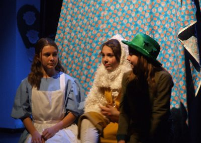 alice talking with the mad hatter and white rabbit