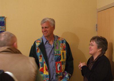 photo of mendoza smiling at his art show