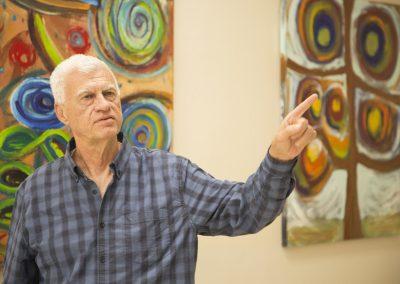 mendoza pointing at his painting