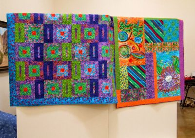 photo of two of mendoza's quilt artworks