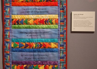 photo of one of mendoza's work with a red border and multicolored shapes and lines