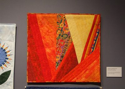 photo of mendoza's quilting work with red and yellow shapes
