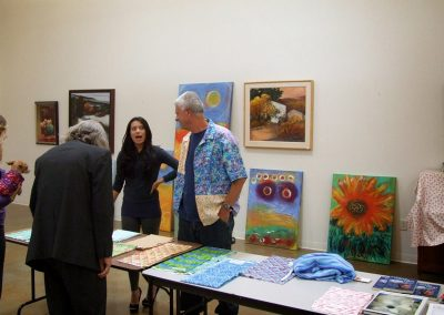 mendoza stood in front of artworks with others