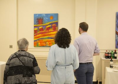 people viewing george mendoza's painting
