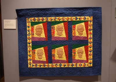 photo of mendoza's quilting work with six heads
