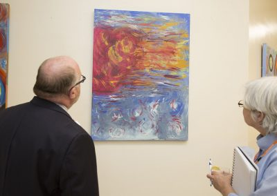 two people observing mendoza's art