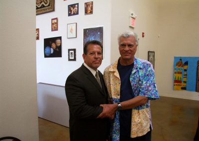 mendoza posed with a man at the art gallery