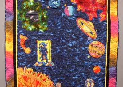 photo of mendoza's quilting work of a man in space