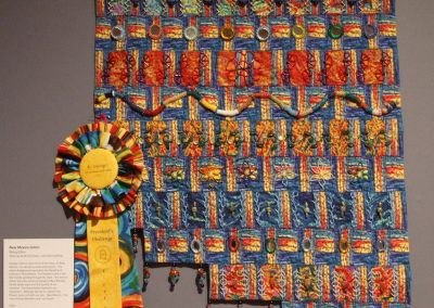 photo of mendoza's quilting work of a multicolored landscape