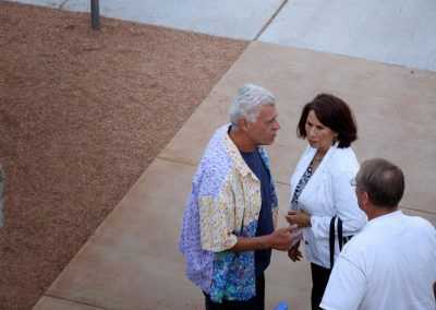 mendoza talking with two people