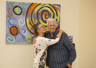 mendoza hugging a woman