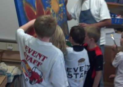 mendoza painting while children help