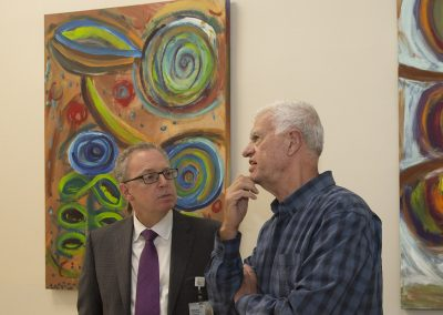 mendoza talking with a man at the gallery
