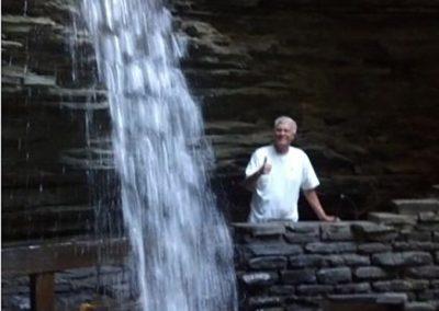 mendoza posing next to a waterfall
