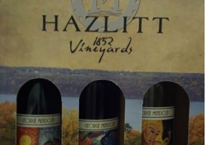 a pack of three wines with mendoza's artwork on the bottles