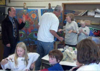 mendoza and others in a classroom making art
