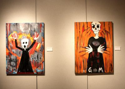 photo of mendoza's artworks in a gallery of two figures