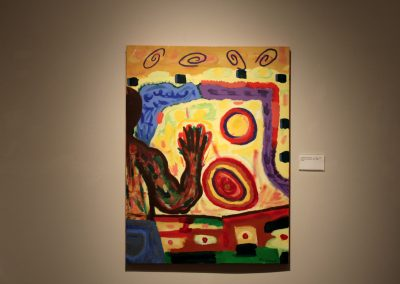photo of mendoza's artwork of a person looking at an abstract landscape