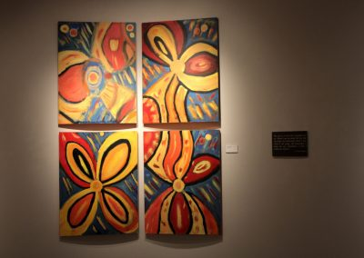 photo of mendoza's artwork of four flower paintings