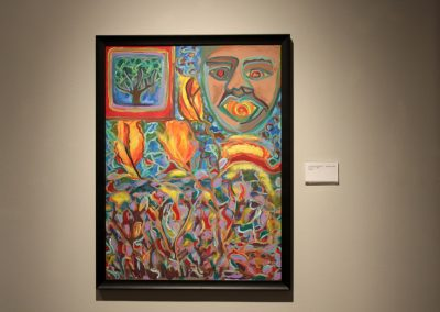 photo of mendoza's artwork of an abstract landscape with a man looking down on the landscape