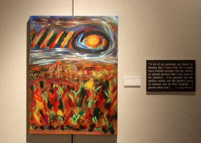photo of mendoza's artwork of an abstract landscape and a orb in the top right