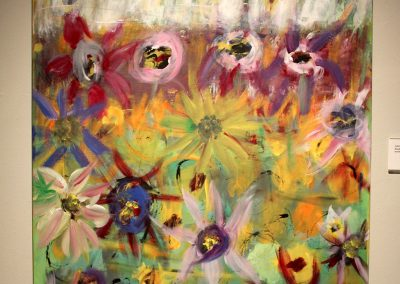 photo of mendoza's artwork of an abstract, colorful painting of flowers