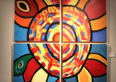 photo of mendoza's artwork of an abstract, colorful painting of a flower