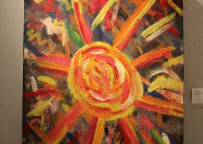 photo of mendoza's artwork of an abstract, colorful painting of the sun